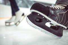 Man's hockey skates and women's figure skates on Royalty Free Stock Photography