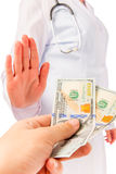 Man's holds out bribe to doctor Stock Images
