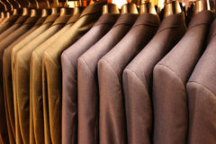 Mens Jackets. A row of mens jackets, in blue and gray tones, at a store Stock Photos