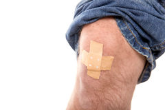 Man´s knee glued medical plaster, isolated on white, concept fi Stock Photos