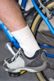 Man's leg on pedal of cycle in lower position Stock Photos