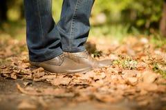 Man's legs in autumn season Royalty Free Stock Images