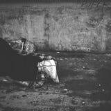 Man`s legs lying in street