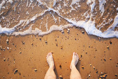 Mans legs on the sand beach Royalty Free Stock Images