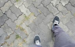 Man's legs stepping forward, making advanced progress. Man's legs stepping forward, abstract meaning for making advanced progress Stock Photo