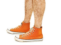 Man's legs in vintage orange shoes Stock Photography
