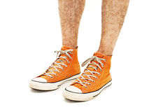 Man's legs in vintage orange shoes Royalty Free Stock Photography