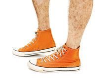 Man's legs in vintage orange shoes Stock Images
