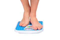 Man's legs ,weighed on floor scale. Stock Images