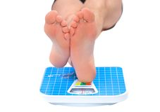 Man's legs ,weighed on floor scale. Stock Photo