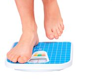 Man's legs ,weighed on floor scale. Stock Photography