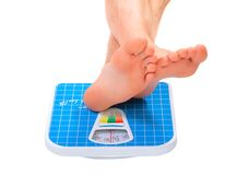 Man's legs ,weighed on floor scale. Stock Photos