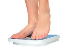 Man's legs ,weighed on floor scale. Royalty Free Stock Photography