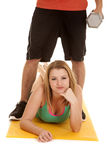 Man's legs weights over woman Royalty Free Stock Images