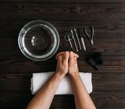Man`s manicure. Men`s hands prepared to manicure. Nail care of the hands. Men`s hands on wooden background top view. Manicure t royalty free stock photo