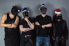 Man's metal band in christmas hats Stock Photos