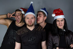 The man's metal band in christmas hats Royalty Free Stock Photos