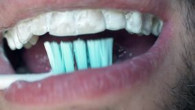 Man`s open mouth and brushes his teeth in morning. Close up white man brushing his teeth with toothbrush. Toothpaste. Man`s open mouth and brushes his teeth in stock video