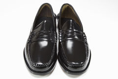 Man's pair of black shoes on white. Pair of new man's black shoes on white Royalty Free Stock Image