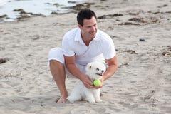 Man plays with dog Royalty Free Stock Photos
