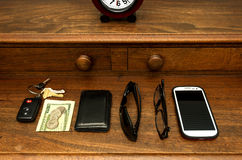 Man's Pocket Items on Dresser Royalty Free Stock Image