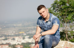 Man's portrait , small city as background Stock Photo
