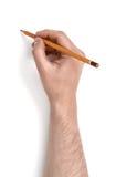 Man& x27; s ręka trzyma ołówek na białym tle Fotografia Royalty Free