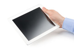 Man's right hand holding a tablet computer. Stock Photography
