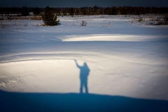 Man's shadow on snow Royalty Free Stock Image