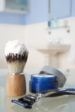 Man's shaving kit in bathroom. On glass shelf Royalty Free Stock Photo