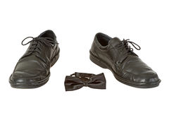 Man's shoe and bow tie Stock Photography