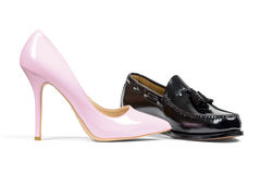 Man's shoe and pink women's heel shoe Royalty Free Stock Image
