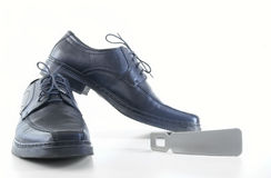 Man's shoes and accessories for footwear. On the white background Royalty Free Stock Photo