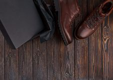 Man`s shoes with box on a wooden background. Man`s brown shoes with box on a wooden background Royalty Free Stock Photography
