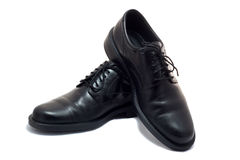 Man's shoes one by one Royalty Free Stock Image