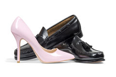 Man's shoes and pink women's heel shoe Stock Image