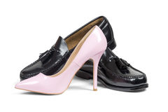 Man's shoes and pink women's heel shoe Royalty Free Stock Image