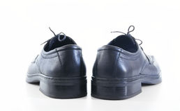 Man's shoes, the rear view. On the white background Royalty Free Stock Photos