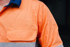 Man's shoulder in hi vis workshirt with copyspace for logo Stock Photos