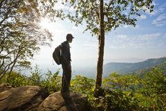 Man's silhouette at a viewpoint overlooking central Thailand Royalty Free Stock Images