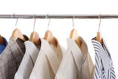 Man's skirts on hangers royalty free stock photos