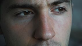 Man`s stern look in close-up