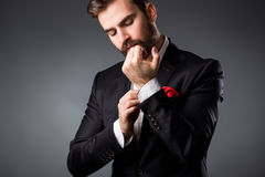 Man's style. Elegant young man getting ready. Dressing suit, shirt and cuffs stock images