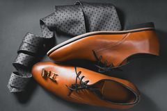 Shoes with tie and cuff. Man`s style. Men`s Accessories. Shoes with tie and cuff Royalty Free Stock Images