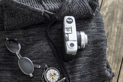 Man's sweater and various personal items Royalty Free Stock Photo