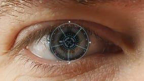Man` s synar med den futuristiska programvarumanöverenheten lager videofilmer