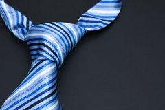 Man's tie on a black background Royalty Free Stock Images