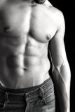 Man's torso. Ma's torso showing great abdominal muscles over a black background Stock Photography