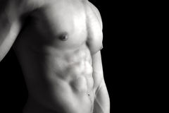 Man's torso. Ma's torso showing great abdominal muscles over a black background Stock Photo