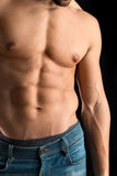 Man's torso. Ma's torso showing great abdominal muscles over a black background Stock Images